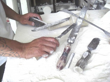 Central Otago District Arts Trust - Andrew Barrs hands with some workshop tools